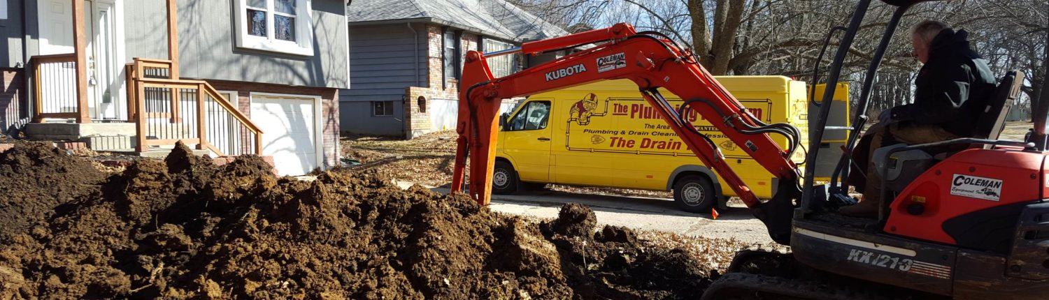 Underground sewer repair job by The Plumbing Pro van