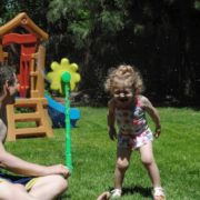 daddy-playing-in-sprinkler-min