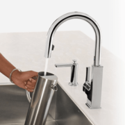 Hands free faucet in use